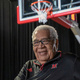 Wayne Embry in front of a basketball hoop