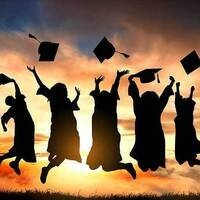 graduates in cap and gown jumping into the sunset