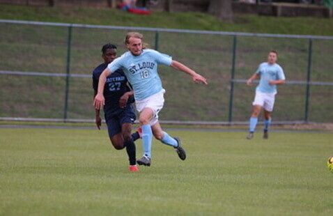 two soccer players in a game