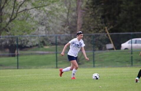 STLCC Female soccer player dribble a ball