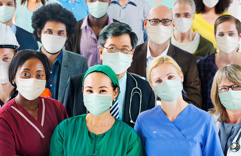 Diverse group of frontline workers wearing masks