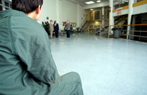 young man in jail hall