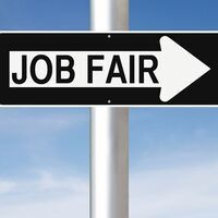 """This is a picture of a street sign with an arrow on it and the arrow reads """"Job Fair"""" The arrow is pointing to the right."""