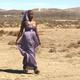 Dancer walking through a desert