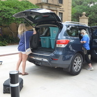Families packing car for move-out.
