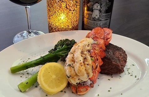 steak and lobster on a plate