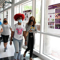 Student and parents tour the Science and Technology Building.