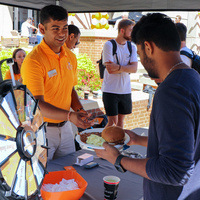 Student gets a plate of BBQ during the Engineering Cookout