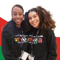 Two ladies in UMOJA sweaters