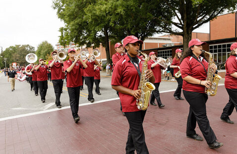 Marching Band marches on Stasavich Place during Homecoming Parade