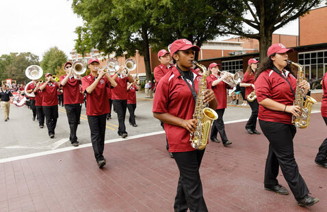 The Marching Band marches on Stasavich Place during Homecoming Parade