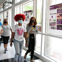 Students and parents tour the Science and Technology Building.