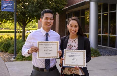 Two PharmD students at scholarship ceremony