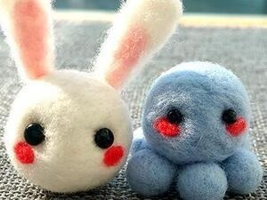 photo of felted white bunny and blue octopus