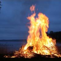 A campfire next to a lake