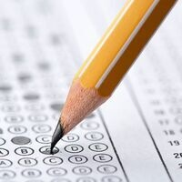 This image has a test scantron on it with a pencil marking the letter C.