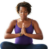 Seated woman meditating with eyes closed