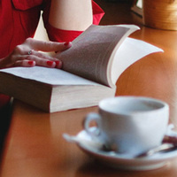 Reader with coffee cup