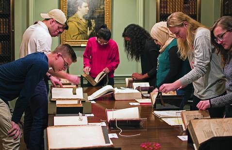 Seminar students examine original documents in Harvard's Houghton Library.