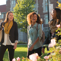 Three females students walk in front of Ayres Hall