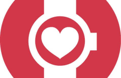 Photo of a heart inside of a watch face.
