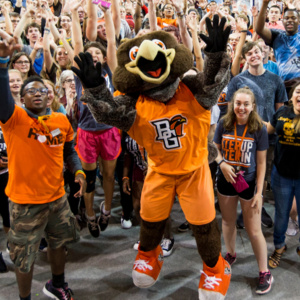 Freddie falcon mascot cheering with students