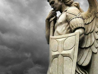 image of an angelic statue holding a shield with a cross image in its left hand