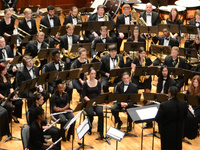 wind ensemble performers on stage
