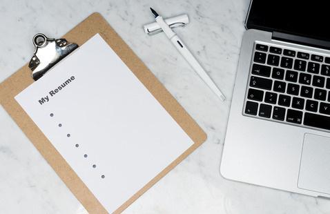 Resume sheet and laptop