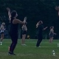 students practicing Zumba on the Quad
