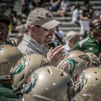 Coach Bill Clark talking to team in a huddle