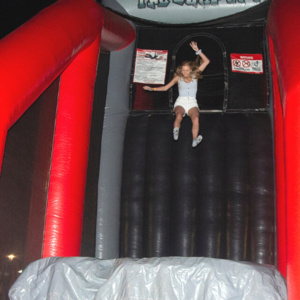 Student jumping out of a large inflatable game