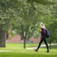Student walking through Pine Grove.
