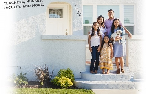 Family standing in front of a home.
