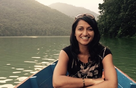 Woman on a boat, smiling in camera