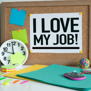 """Bulletin board with papers that say """"I Love My Job!"""""""