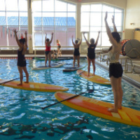 participants doing yoga on SUP boards