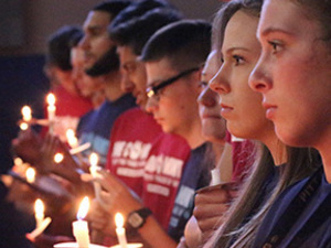 Students holding candles during First-Year Student Convocation