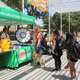Students receiving snacks and other giveaways at the Margaret McDermott Trellis Plaza.