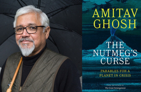 Author Amitav Ghosh, smiling, in black shirt with brown vest, and eyeglasses, holding an umbrella, alongside the cover of his book.