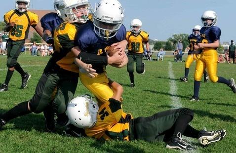 Kids playing tackle football