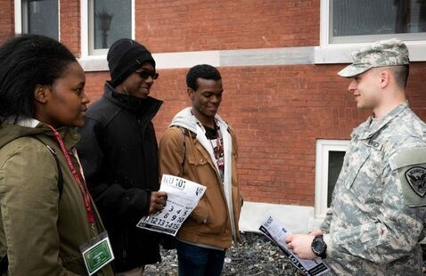 Cadet speaking with visiting family.