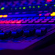 a close up of a mixing board, with lots of glowing lights