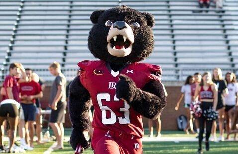Joe Bear mascot runs across the Moretz field during 828 Day celebration