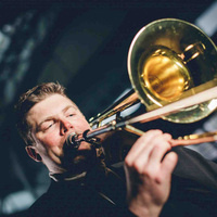 color photograph of Jemmie Robertson playing the trombone