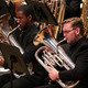 brass players performing on stage