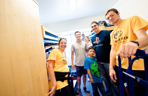 Student and their family in a residence hall room.