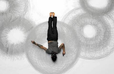 Featured image: Tony Orrico performing 8 Circles. Photo by Michael Hart