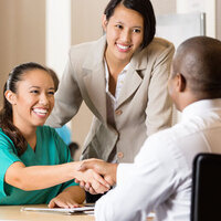 job fair, female shaking hands with male businessman