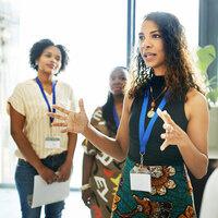 female speaking at job fair